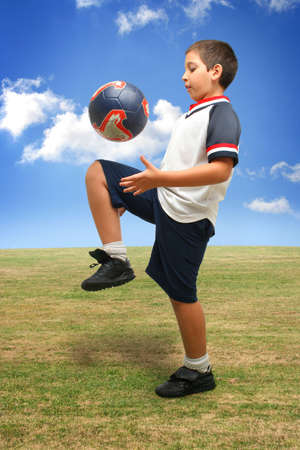 Sports. Boy playing soccer (ball on air). From my football series photo