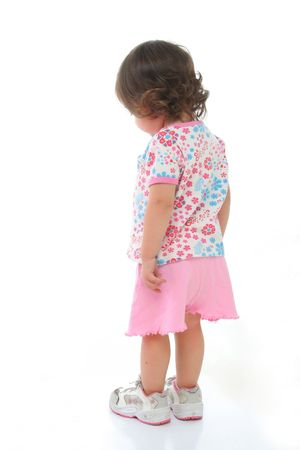 Dreamy toddler seen from behind. More pictures of this  at my gallery Stock Photo