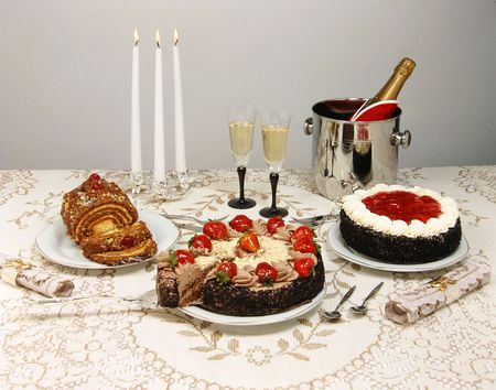 holiday catering: Dessert table with cakes ( strawberry and chocolate ), candles and champagne. Look at my gallery for more images of food Stock Photo