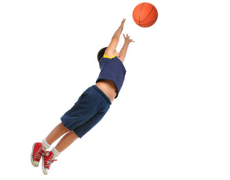 strong boy: Boy playing basketball isolated. Flying and jumping. From my sport series.