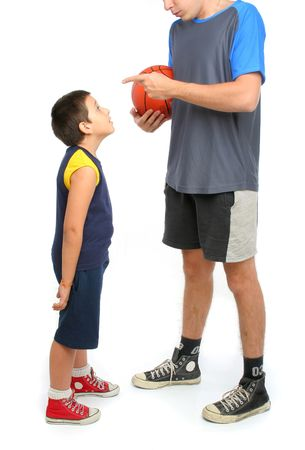 little boy asking big man to play basketball . From my sport series. photo