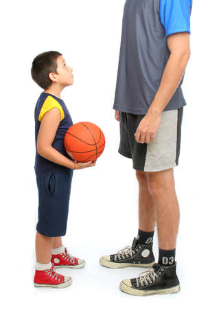 coach sport: little boy asking big man to play basketball . From my sport series. Stock Photo
