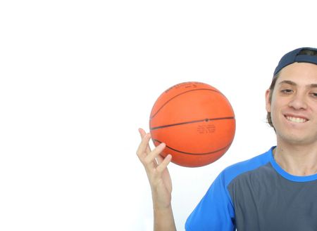 Young man playing basketball isolated. Funny expression From my sport series. Stock Photo - 453566