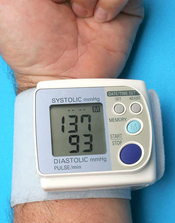 systolic: Blood pressure digital monitor. Medical object over blue background.
