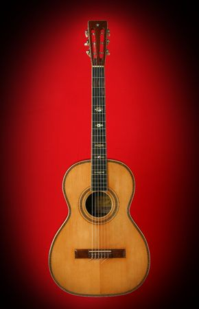 Guitar over red background. Beautiful musical instrument Stock Photo