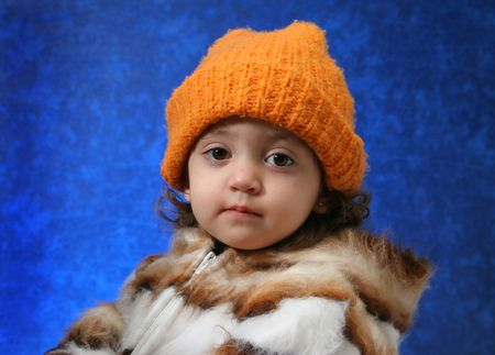 Little girl in winter outfit looking at camera. Look at my gallery for more winter images photo