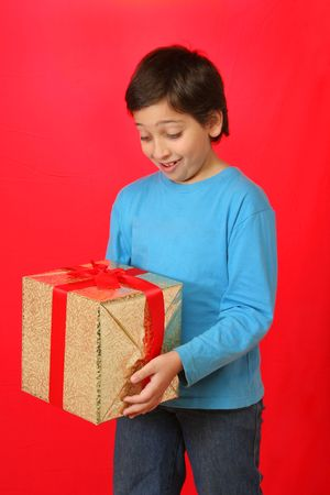 Cute boy with a christmas gift Stock Photo - 523067