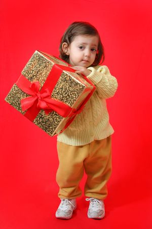 Cute little girl with a christmas gift photo