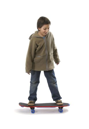 cool boy: Cool boy skateboarding. Full boy, white background. More pictures of this model at my gallery Stock Photo