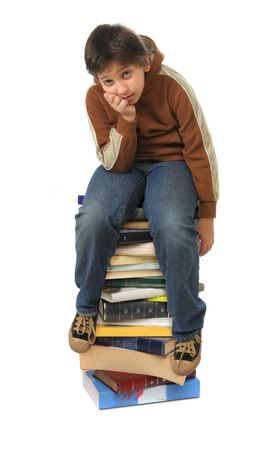 Boy sitting on a big pile of books. Different expressions (series) photo
