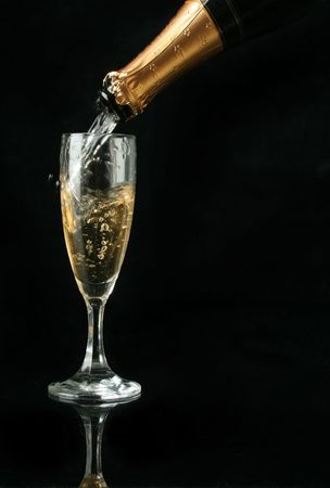 fresh graduate: Pouring a champagne flute for celebration time