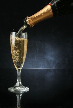 Pouring a champagne flute for celebration time Stock Photo - 597370