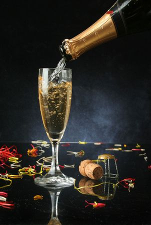 fresh graduate: Pouring a champagne flute for celebration time (with confetti)