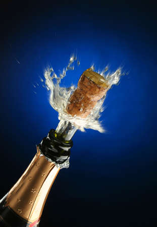 champagne flutes: Champagne splash. Bottle and cork, celebration time Stock Photo