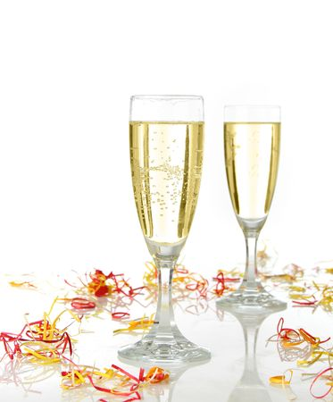 fresh graduate: Pair of champagne flutes ready for celebrate. Confetti and white background