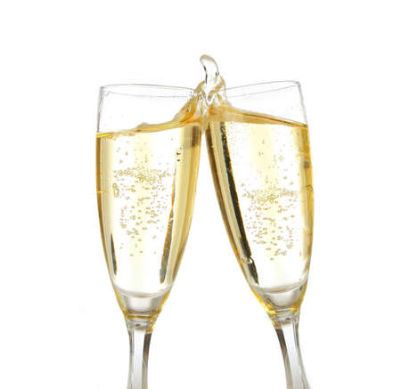 Pair of champagne flutes making a toast. Champagne splash Stock Photo - 604253