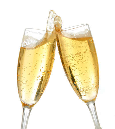 Pair of champagne flutes making a toast. Champagne splash Stock Photo - 604230