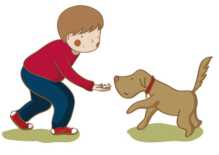 Boy giving cookies to his dog