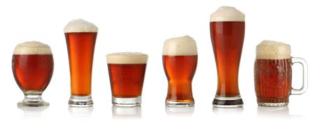 Different glasses of cold beer, isolated on white Stock Photo