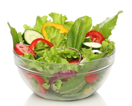 bowl: Delicious salad on a bowl isolated over white Stock Photo