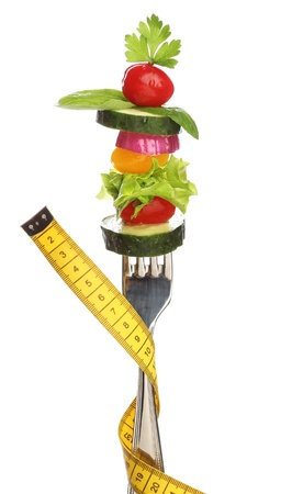 Mixed vegetables on a fork isolated  Diet concept photo
