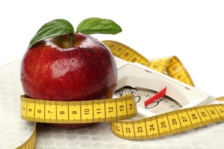 low calories: Red apples and a measuring tape over white