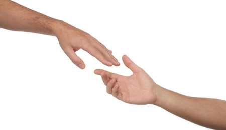 Two male hands reaching towards each other  Isolated