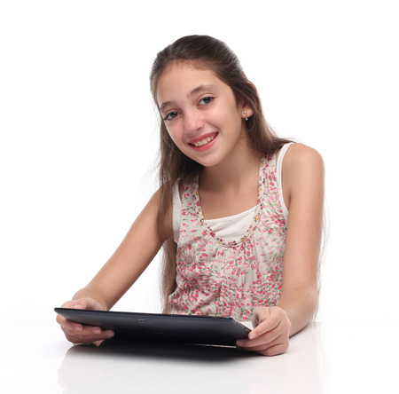 beautiful preteen girl: Beautiful preteen girl with a tablet computer. Isolated.