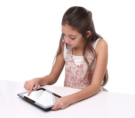 beautiful preteen girl: Beautiful preteen girl using a tablet computer. Isolated on white Stock Photo
