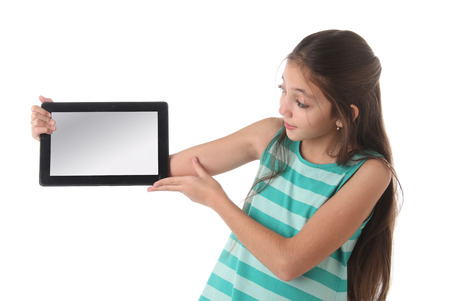 latin child: Beautiful preteen girl with a tablet computer. Isolated.