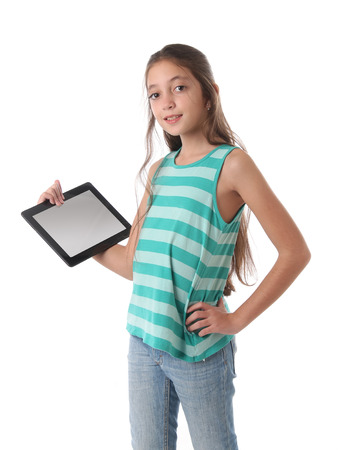 beautiful preteen girl: Beautiful preteen girl with a tablet computer. Isolated. Clipping path for the screen