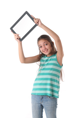 average guy: Beautiful preteen girl with a tablet computer. Isolated. Clipping path for the screen