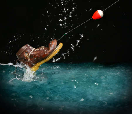disenchantment: Catching an old shoe with a fishing pole. Splash of water Stock Photo