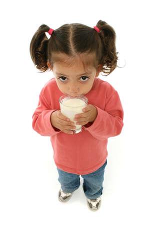drinking milk: Toddler enjoying a glass of fresh milk