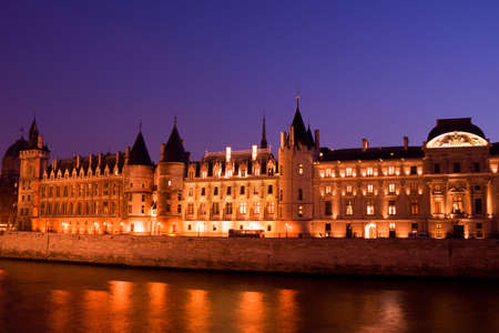 jailhouse: Twilight view of the Conciergerie (old medieval jailhouse) and the Seine river - Paris, France Stock Photo