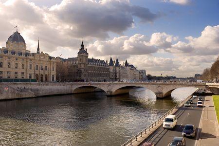 La Conciergerie and Pont au Change, over the Seine river - Paris, France Stock Photo