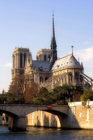slightly: Back view of Notre-Dame cathedral slightly before dusk - Paris, France Stock Photo
