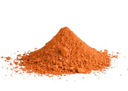 A pile of red ochre powdered pigment isolated on a white background Stock Photo