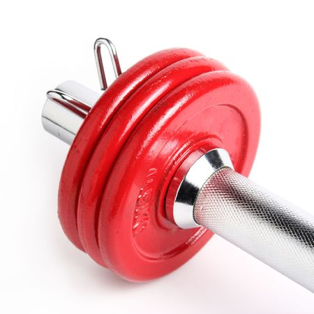 Close-up view of a red dumbbell isolated on a white background Stock Photo - 360542
