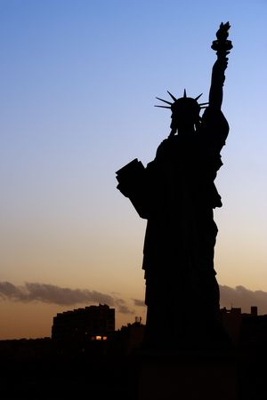 parisian: Silhouette of the Parisian Statue of Liberty - Paris, France Stock Photo