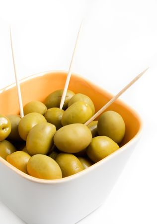 toothpick: A cup of green olives isolated on a white background