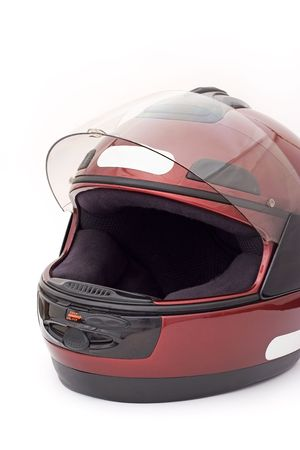 A full-face motorbike helmet isolated on a white background