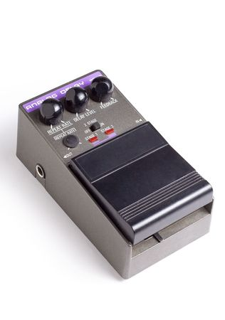 pedal: An analog delay guitar effects pedal isolated on a white background