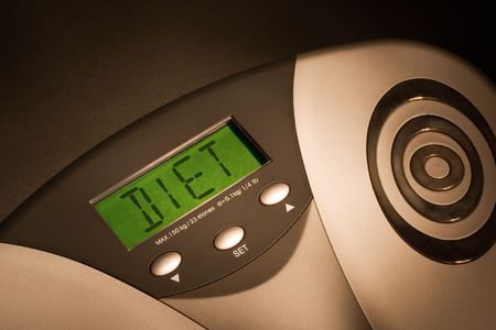 Bathroom scale showing DIET on its display Stock Photo - 410533