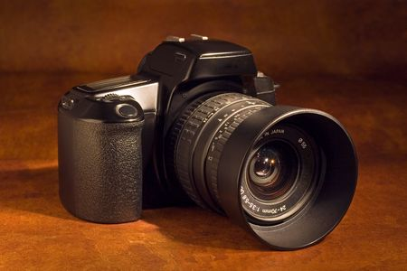 A 35mm SLR camera with standard zoom lens Stock Photo