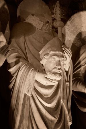 Stone statue of a Saint on the front porch of Notre-Dame cathedral - Paris, France Stock Photo - 522963