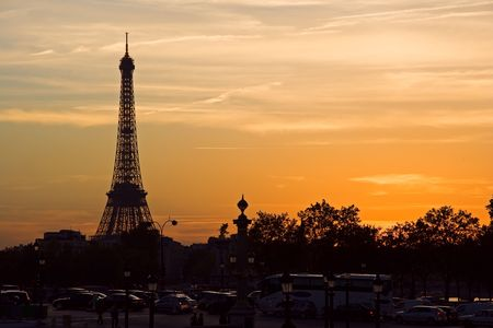 Silhouette of the Eiffel tower at sunset - Paris, France photo