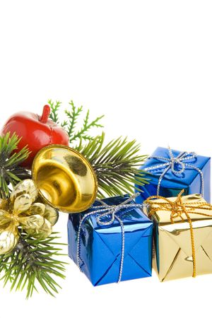 Fir branch with Christmas gifts and decorations