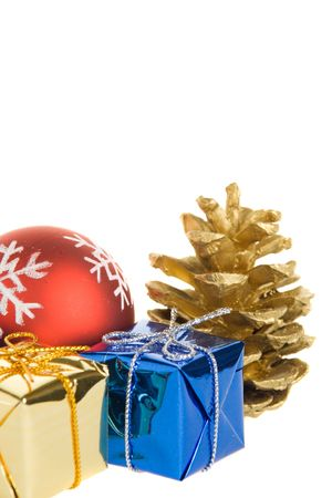 Christmas gifts, red balls and golden pine cones