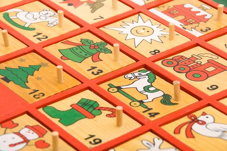 Close-up view of a hand painted wooden advent calendar photo
